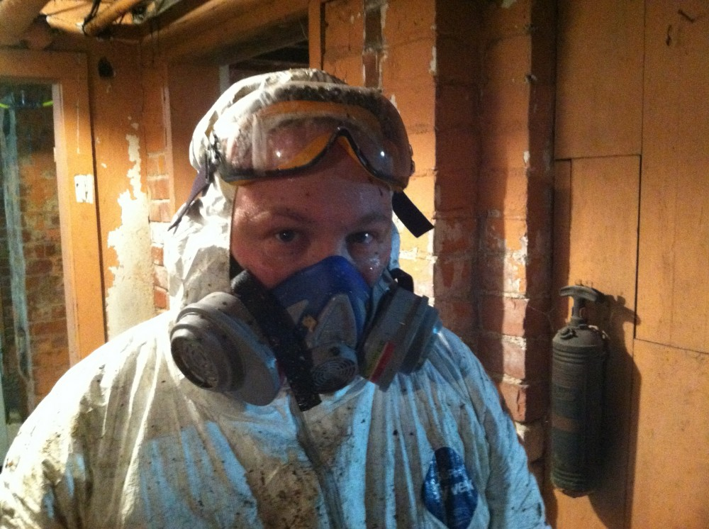 Asbestos removal was a days-long steaming hot mess of exhaustion.